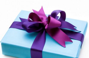 Gift-box-with-blue-wrapping-and-purple-ribbon460x300